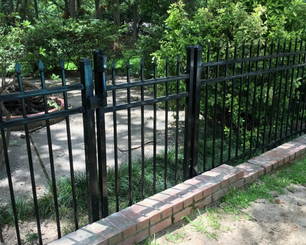 Gate on fence between pool and fire pit | rainerlife.com