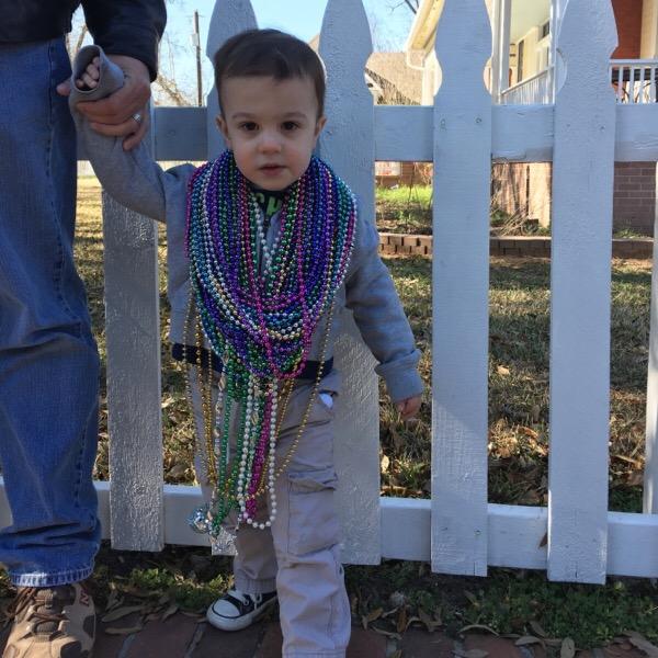 Gavinand his beads at Mardi Gras parade | rainerlife.com