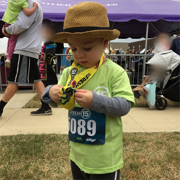 Gavin with his race medal | rainerlife.com