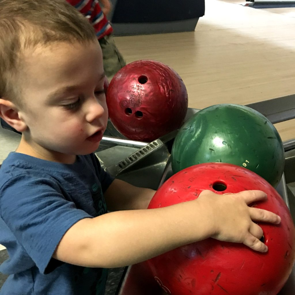 Gavin picking a bowling ball | rainerlife.com