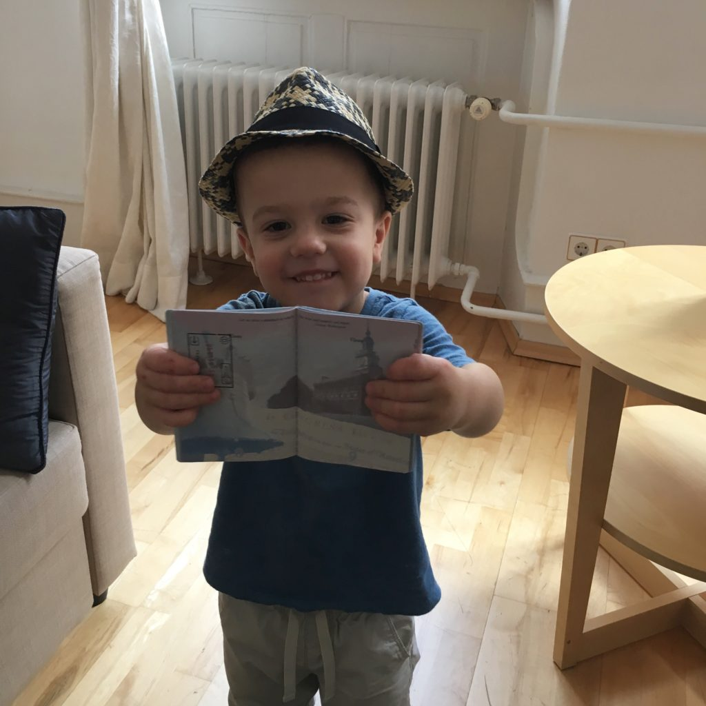 Gavin with his first stamp in his passport! | rainerlife.com