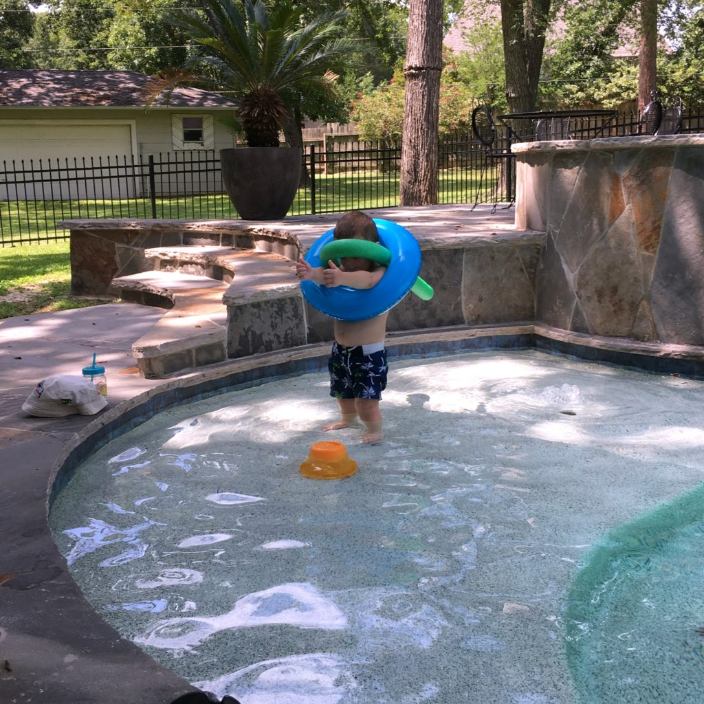 Gavin playing robot in the pool | rainerlife.com