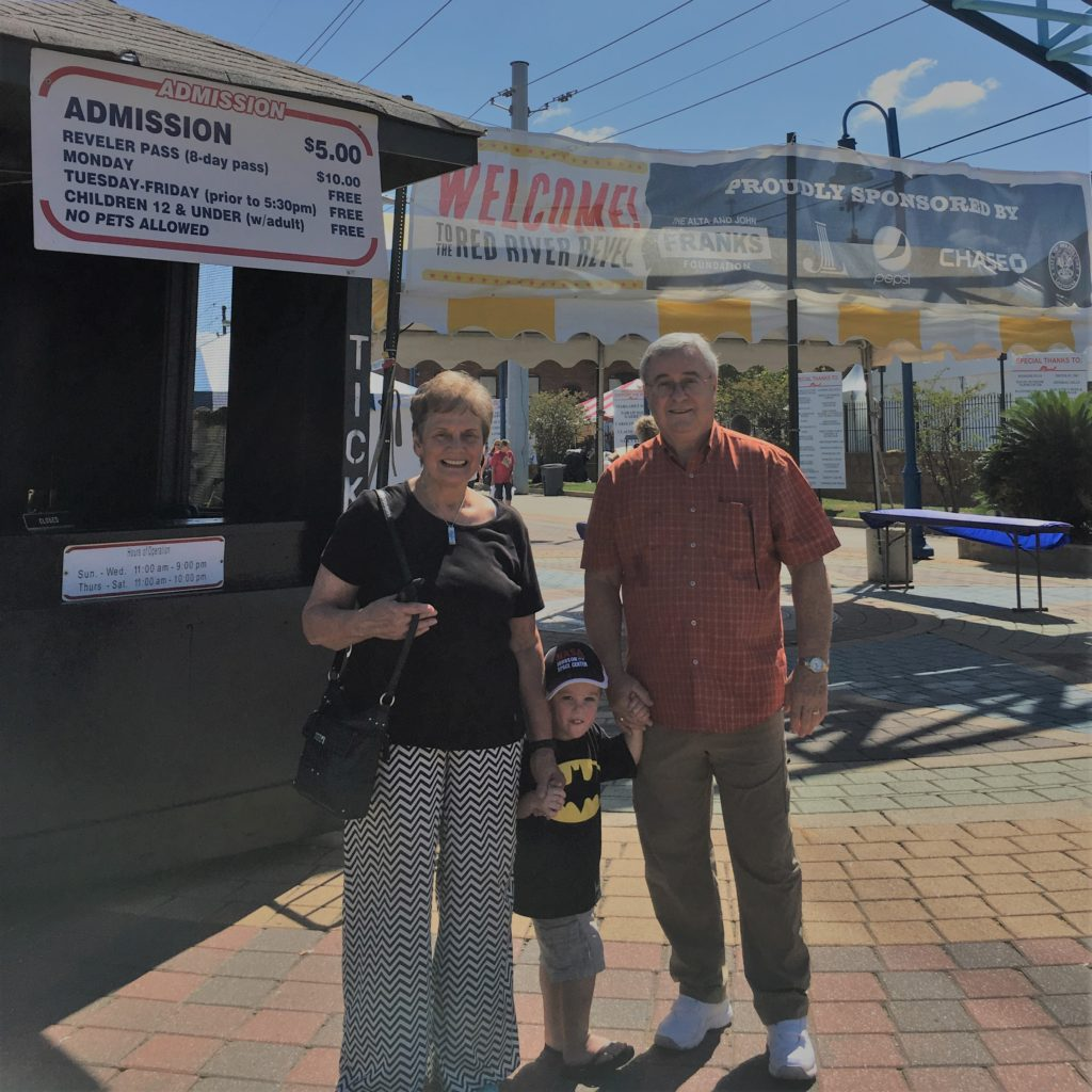 Gavin with his Grandma and Grandpa at the Red River Revel | rainerlife.com