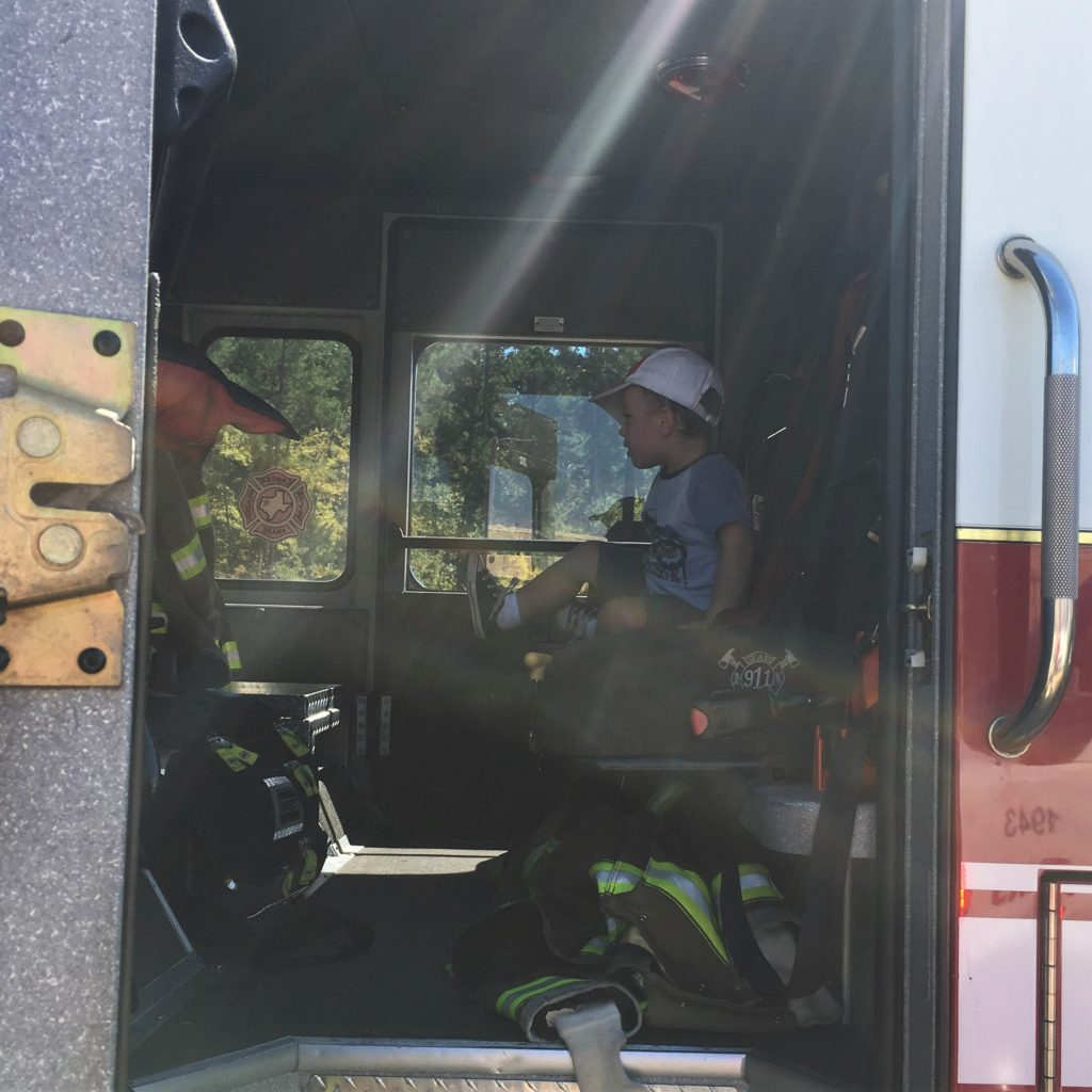 Gavin on a firetruck | rainerlife.com