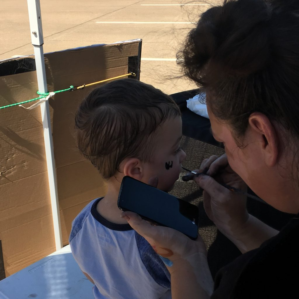 Gavin getting his face painted | rainerlife.com